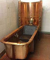 Copper bath with restraints.