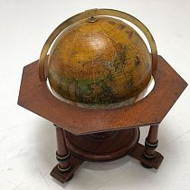 Tabletop globe on stand.
