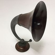 Amplification horn on wooden stand