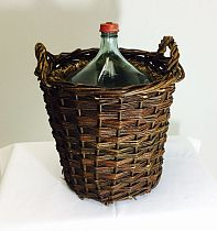 Glass flagon in basket