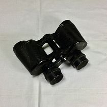 Vintage binoculars12 cm in length.