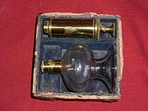Antique breast pump, glass and laquered brass