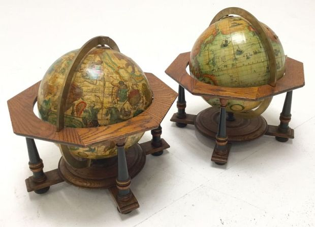 Pair of desktop globes.