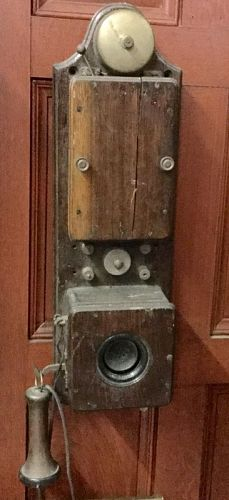 Wall-mounted, vintage telephone