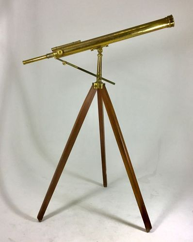 Brass telescope on wooden tripod